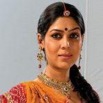 The host original name is Sakshi Tanwar