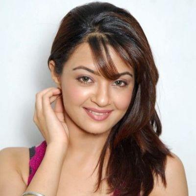 Charu Sinha original name is Surveen Chawla