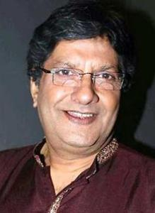 The father of Ravi and Mahesh original name is Anil Dhawan
