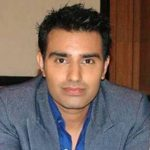 Dr. Umesh 'Omi' Joshi original name is Sanjit Bedi