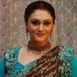 Radha Malhotra original name is Eva Grover