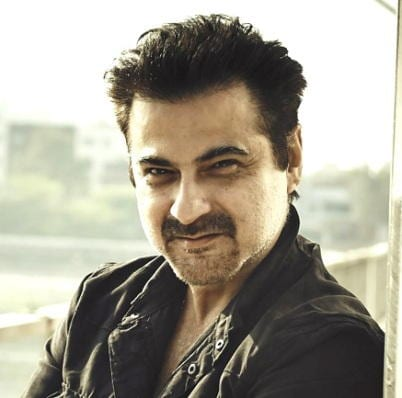 Amar original name is Sanjay Kapoor